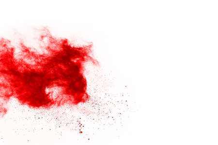 Foto de Freeze motion of red powder exploding, isolated on white background. Abstract design of red dust cloud. Particles explosion screen saver, wallpaper - Imagen libre de derechos