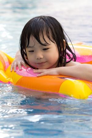 Little girl is having fun in swimming pool