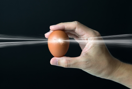 New life concept with hand holding a cracked egg