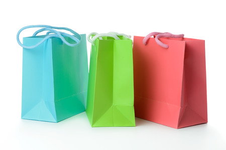 Red, green and blue gift bags isolated on white background