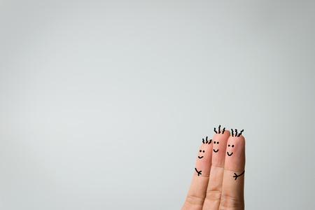 Happy three fingers hug on grey background