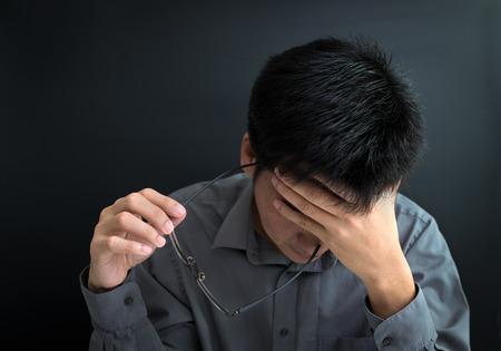 Businessman under stress, fatigue, worry and upset