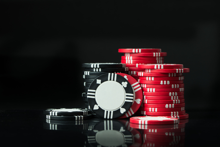Stacks of poker chips isolated on black background