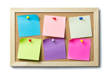 Multicolor blank post it notes on a cork notice board