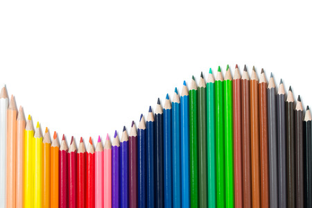 Foto de Spectrum color pencils set arranged in S curve isolated on white background - Imagen libre de derechos