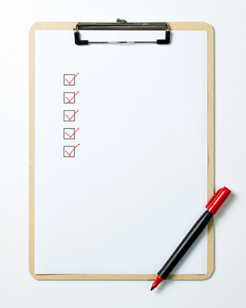 Photo pour Checklist on clipboard with a red pen isolated on white background - image libre de droit
