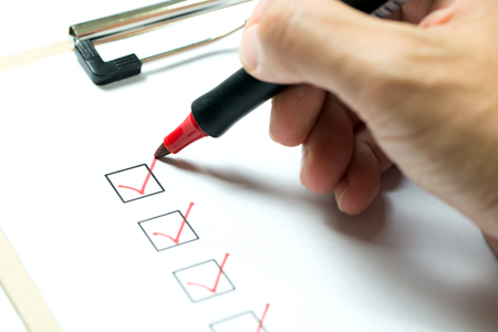 Photo pour Checklist marked red with a red pen - image libre de droit