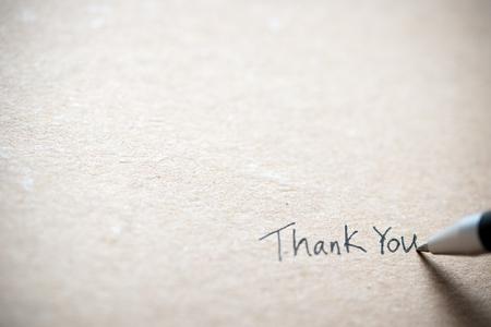 Foto de Hand writing thank you on piece of old grunge paper - Imagen libre de derechos