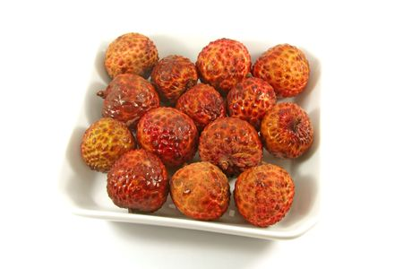 Plate of Lychees On a White Background