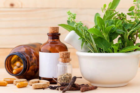 Photo for Alternative health care fresh herbal  ,dry and herbal capsule with mortar on wooden background. - Royalty Free Image