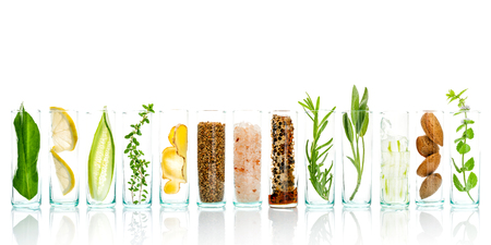 Foto de Homemade skin care and body scrubs with natural ingredients aloe vera ,lemon,cucumber ,himalayan salt ,peppermint ,lemon slice,rosemary,almonds,cucumber,ginger and honey pollen isolate on white background. - Imagen libre de derechos