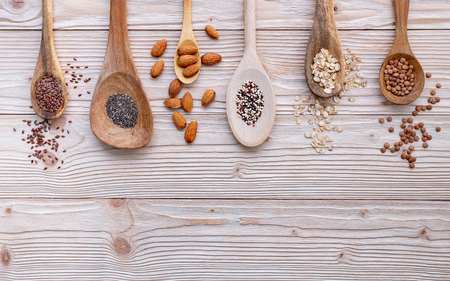 Photo for Different types of grains and cereals on shabby wooden - Royalty Free Image