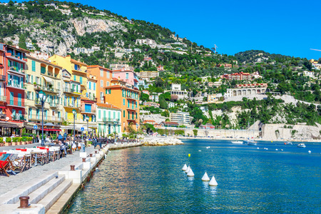 Panoramic view of coastline and beach with blue sky, luxury resort and bay with yachts, Nice port, Villefranche-sur-Mer, Nice, Cote d'Azur, French Riviera.