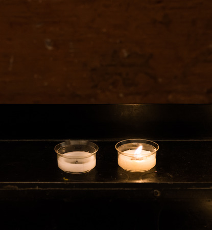 A cup of candle on the candle stand in the church