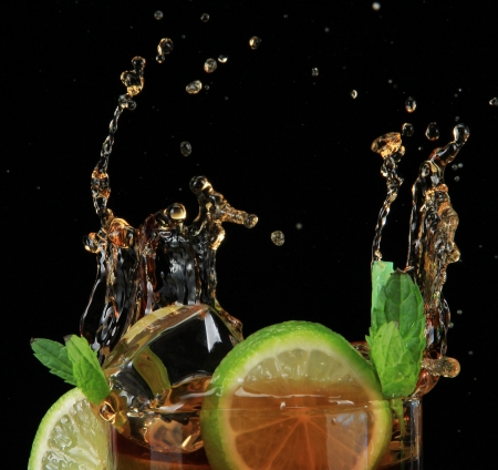 Cuba libre cocktail on black background