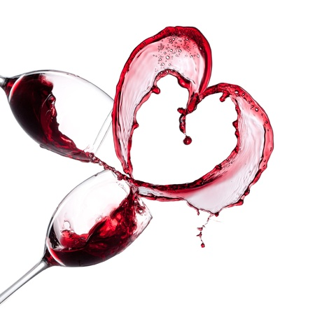 Red wine heart over white background