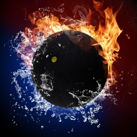 Squash ball in fire flames and splashing water