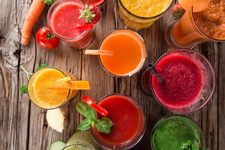 Fresh fruit and vegetables juice on wooden table