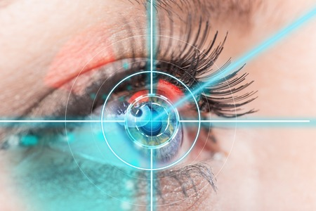 Close-up woman eye with laser medicine, technology concept.の写真素材