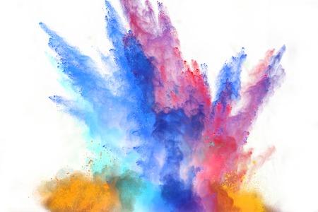 Foto de Launched colorful powder, isolated on white background - Imagen libre de derechos