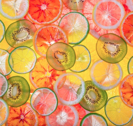 Sliced fruits background, close-up.
