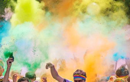 Foto de Close-up of marathon, people covered with colored powder. - Imagen libre de derechos