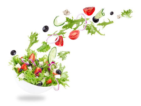 Photo for Fresh salad with flying vegetables ingredients isolated on a white background. - Royalty Free Image