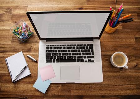Photo pour Office work place with notebook - image libre de droit