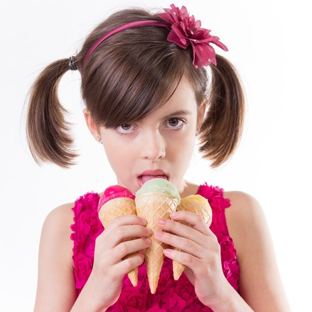 little girl with ice cream in studio, isolated on white.