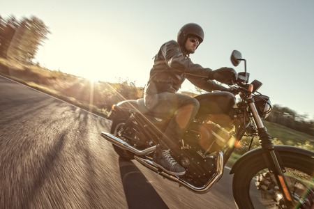 Photo for Man seat on the motorcycle on the road during sunrise. - Royalty Free Image