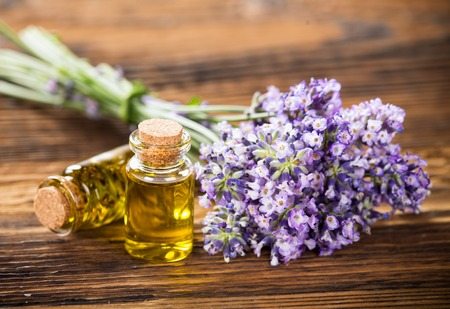 Wellness treatments with lavender flowers on wooden table.