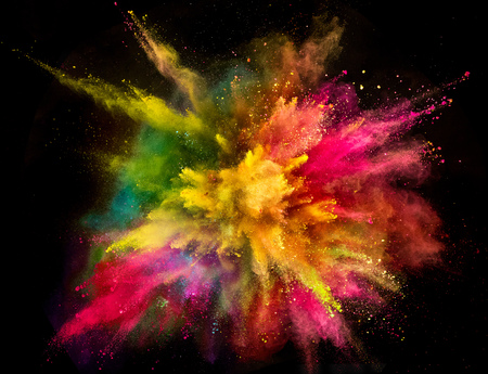 Foto de Colored powder explosion on black background. - Imagen libre de derechos