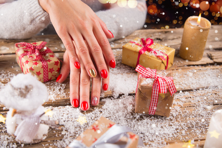 Photo for Woman with beautiful red nails on vintage wooden table - Royalty Free Image