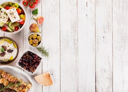 Foto de Greek food background. Traditional different greek dishes , top view. Close-up - Imagen libre de derechos