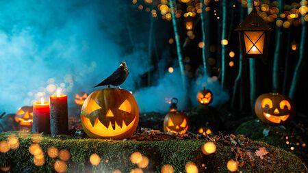 Foto de Halloween pumpkins on dark spooky forest. - Imagen libre de derechos