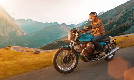 Photo pour Motorcycle driver riding in Alpine highway, Nockalmstrasse, Austria, Europe. - image libre de droit