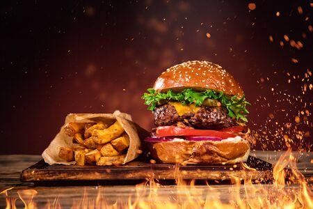 Foto für Tasty burger with french fries and fire. - Lizenzfreies Bild