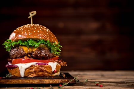 Photo for Tasty burger on wooden table. - Royalty Free Image