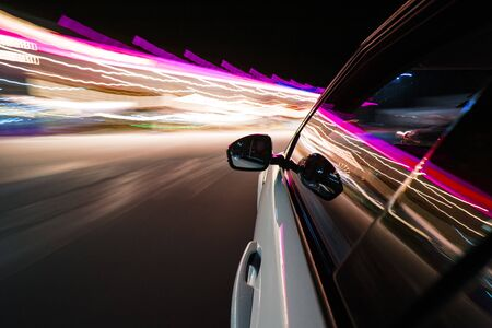 Photo for View from side of car moving in a modern night city, blurred motion with lights and cars. - Royalty Free Image