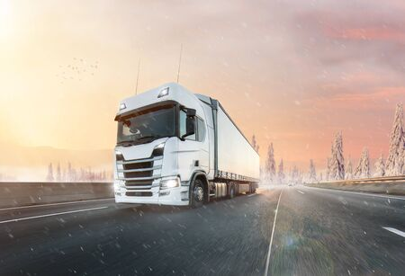 Photo pour Truck with container on winter road, cargo transportation concept. - image libre de droit