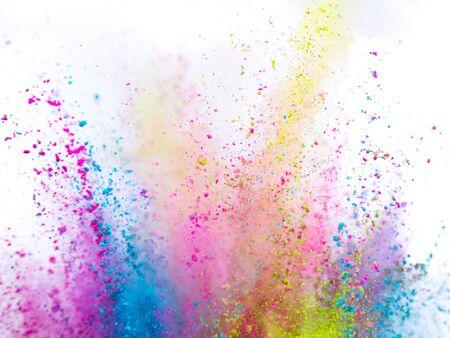 Foto de Colored powder explosion on white background. - Imagen libre de derechos