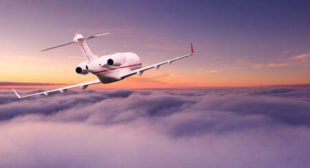 Photo pour Small private jetplane flying above beautiful clouds. - image libre de droit