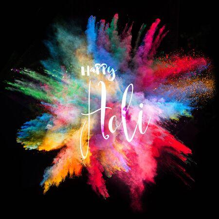 Foto de Colored powder explosion on black background. Freeze motion. - Imagen libre de derechos