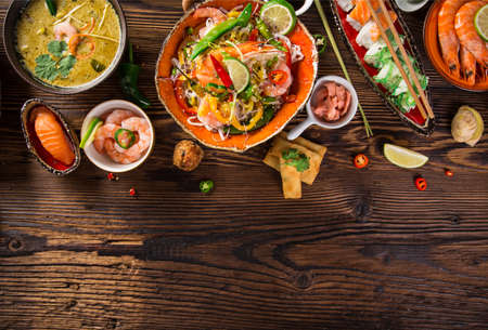 Photo pour Asian food background with various ingredients on rustic wooden background , top view. - image libre de droit