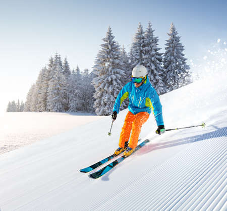 Photo for Skier skiing downhill in high mountains - Royalty Free Image