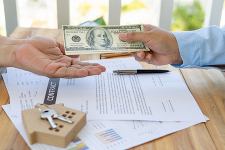Foto de The business of borrowing money to buy a house with financial documents and tax inspections from a consultant when checking through will make an agreement and contract buy a home. - Imagen libre de derechos