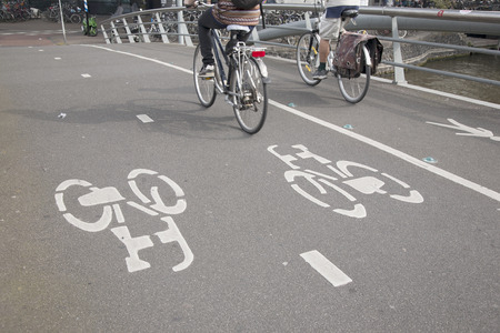 Cyclists on Bike Lane in Amsterdam, Holland, Netherlands