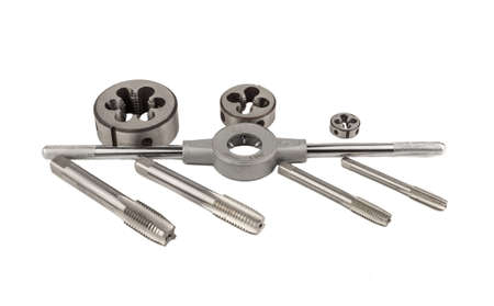 Set of taps and dies for threading on a white background