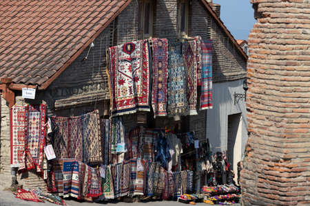 Sighnaghi, Georgia 05/10/2019 In the city of love craft market selling carpets. These traditional style and design carpets woven by hand are a main local industry in the Kakheti area. Many people travel to Sighnaghi because it is the city of love and marr