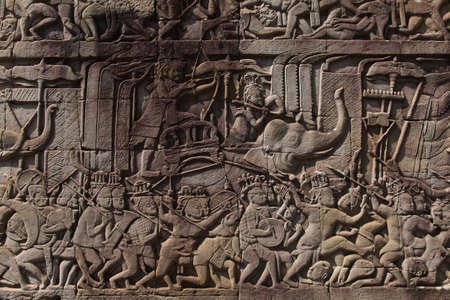Photo for The temple complex of Angkor Watt, Cambodia wall relief depicting ancient wars - Royalty Free Image